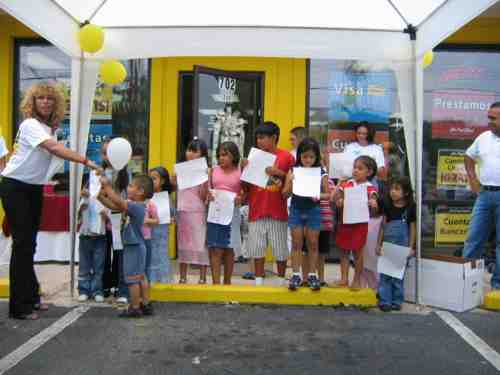 We crafted a communications strategy based on the cultural insights obtained and implemented an Integrated Local Sales and Marketing Strategy.   Photo of grassroots marketing efforts El Banco de Nuestra Comunidad